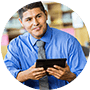 education administration professional on tablet