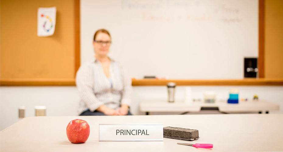 female principal sitting in her office