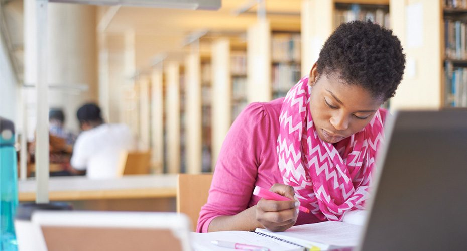 african american female student studying for her master's in education degree