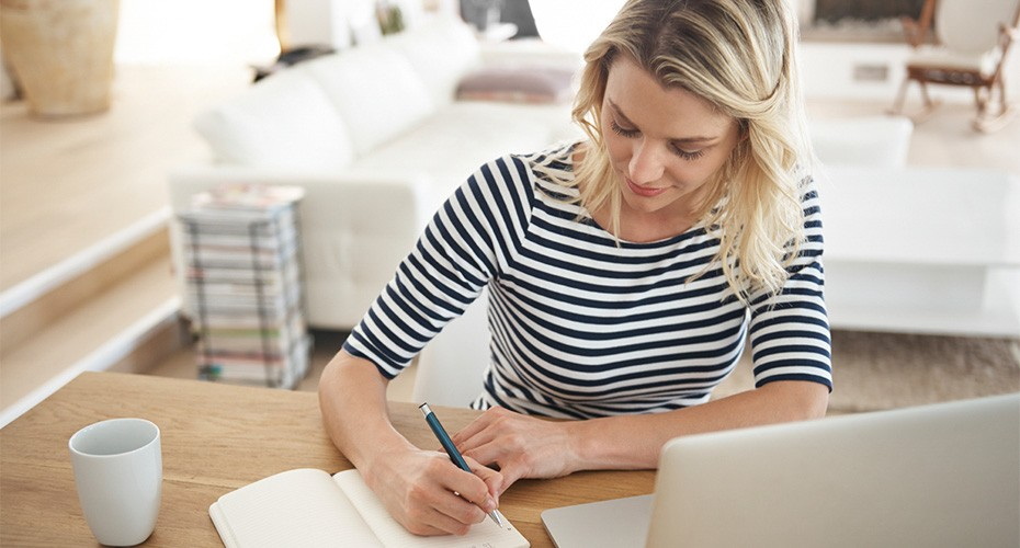woman studying for her master's in tesol works on an assignment