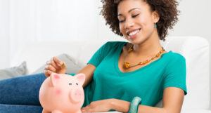 student saving money in piggy bank from arra stimulus plan for financial aid for teaching college